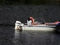Nudist couple has fun in the middle of a beautiful lake on Watchteencam.com
