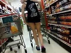 Sexy chick in shorts at supermarket on Watchteencam.com