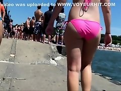British friends walk near the sea in flimsy bikinis on Watchteencam.com