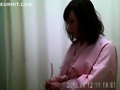 Hidden camera in the dressing room films Asian chicks chang on Watchteencam.com