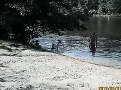 Naked pregnant redhead out on the lake on Watchteencam.com