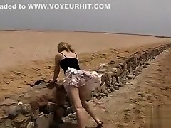 Naughty blonde uses the wind to expose her butt on Watchteencam.com