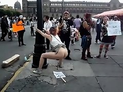 Female agitator pees and poops on a poster at a rally in protest to the government on Watchteencam.com