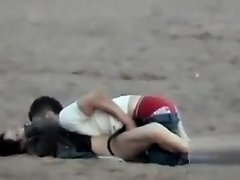 German couple makes love on the deserted beach on Watchteencam.com