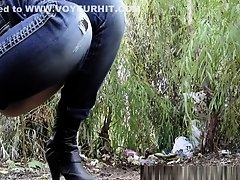 Tight pants blonde pissing in wild on Watchteencam.com