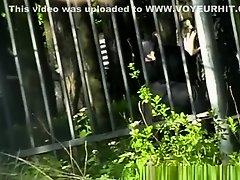 Woman pissing in public park on Watchteencam.com