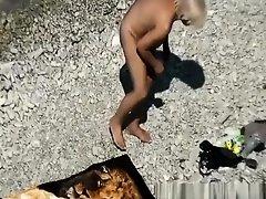 Mature nudist woman in the water on Watchteencam.com