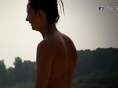 Topless beauty in tiny thong on beach voyeur camera on Watchteencam.com