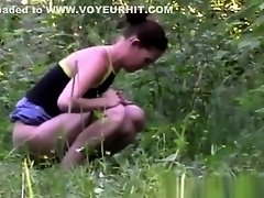 Girl Peeing on Grass on Watchteencam.com