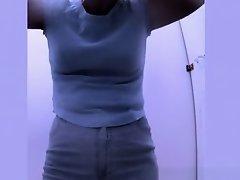 Woman changes bikini for bra and shorts on Watchteencam.com