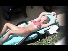 nice view of a blonde teaser by the pool on Watchteencam.com