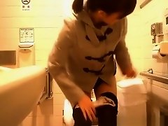Asian woman caught in public toilet peeing on Watchteencam.com