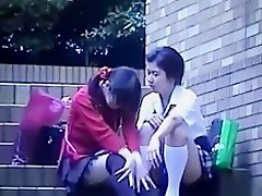 Voyeur tapes a japanese lesbian and straight couple having sex in public on Watchteencam.com