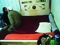 Voyeur tapes an arab hijab girl having missionary sex with a guy on the bed on Watchteencam.com