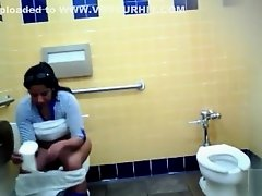 Thick Mexican woman piddles and washes her genitals in the restroom on Watchteencam.com