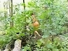 Cutie clothed as an indian sucks ding-dong in the woods