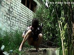 Woman in long dress pees outdoors on Watchteencam.com