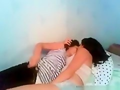 Dude tapes 2 hot girls making-out and teasing on the bed on Watchteencam.com