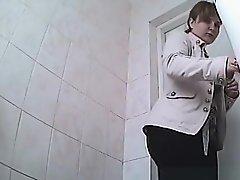 Chubby woman peeing in toilet on Watchteencam.com