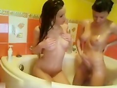 Two lesbian girlfriends helping each other on Watchteencam.com