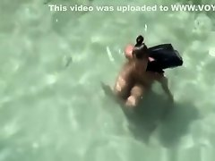 Nudist woman spied in rocky beach on Watchteencam.com