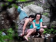 Two brunette women spied pissing outdoors on Watchteencam.com