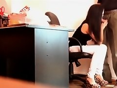Hidden cam films a slim secretary blowing a big boss's cock on Watchteencam.com