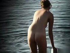 Nudist woman in water on Watchteencam.com