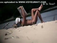 Nudist sunbathing in river shore on Watchteencam.com