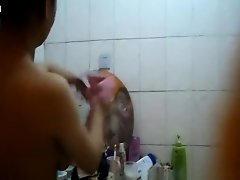 Asian woman showering and drying on Watchteencam.com
