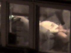 Lovely babe filmed masturbating through apartment window on Watchteencam.com